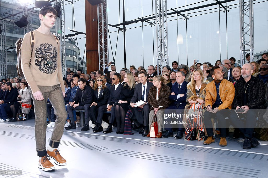 Actor Jeremie Laheurte, Marisa Berenson, Formula One World Champion Lewis Hamilton, Louis Vuitton's executive vice president, Delphine Arnault, Singer Bryan Ferry, Miss Michael Burke, Chief Executive Officer of Louis Vuitton, Michael Burke and Model Kate Moss, Football Player Hidetoshi Nakata and Singer Michael Stipe (REM) the Louis Vuitton Menswear Fall/Winter 2015-2016 Show as part of Paris Fashion Week on January 22, 2015 in Paris, France.