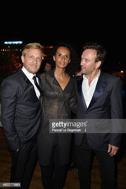 Actor Jeremie Renier, Karine Silla and Vincent Perez attend the Dior & ELLE Magazine Dinner at the 67th Annual Cannes Film Festival at Albane by...