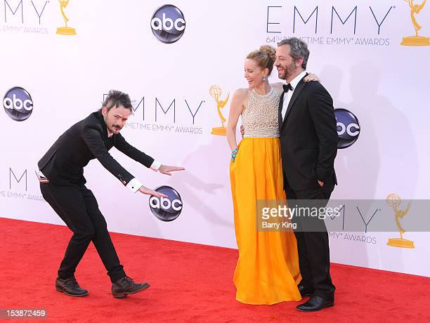 Actor Jeremy Davies actress Leslie Mann and director Judd Apatow arrive at the 64th Primetime Emmy Awards at Nokia Theatre LA Live on September 23...