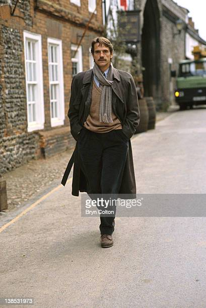 Actor Jeremy Irons walks through the village of Walsingham during the filming of 'Waterland' in Walsingham UK in May 1992 The film is based on the...