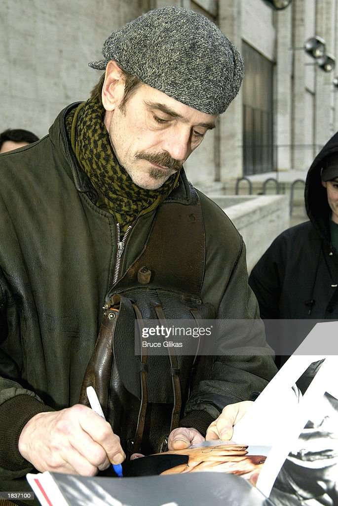 Actor Jeremy Irons, who plays 'Fredrik Egerman' in the New York City Opera's production of Stephen Sondheim's 'A Little Night Music', signs an autograph after the opening weekend at The New York State Theater at the Lincoln Center on March 8, 2003 in New York City.