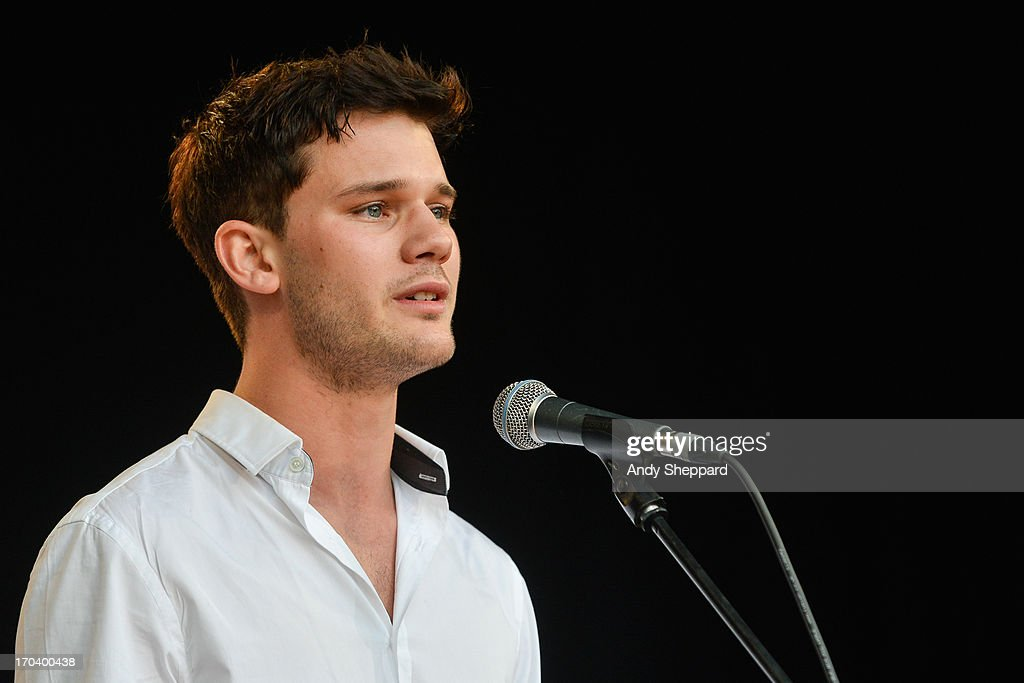 Actor Jeremy Irvine performs on stage in support of One campaign's Agit8 event at Tate Modern on June 12, 2013 in London, England.