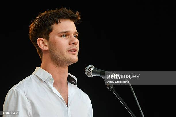 Actor Jeremy Irvine performs on stage in support of One campaign's Agit8 event at Tate Modern on June 12 2013 in London England