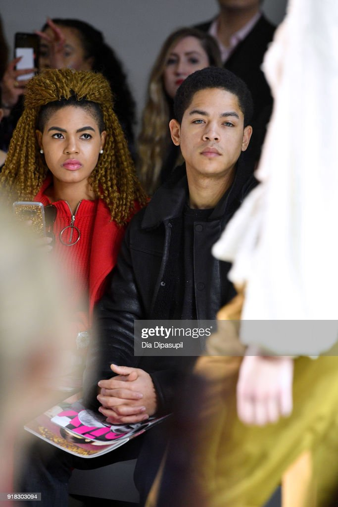 Actor Jeremy L. Carver (R) attends the Marcel Ostertag front row during New York Fashion Week: The Shows at Gallery II at Spring Studios on February 14, 2018 in New York City.