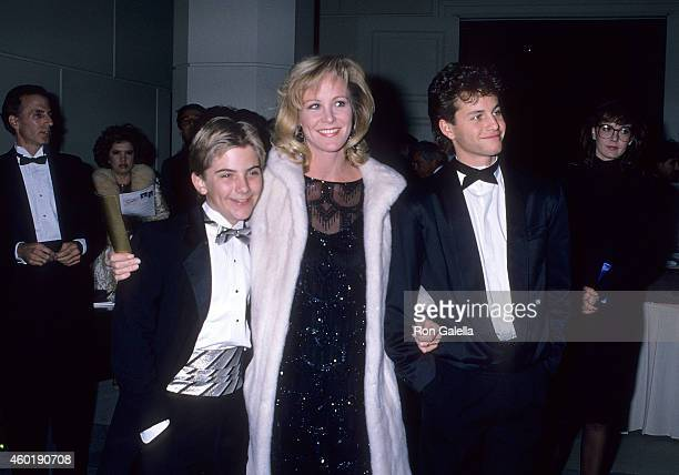 Actor Jeremy Miller actress Joanna Kerns and actor Kirk Cameron attend the Sixth Annual American Cinema Awards on January 6 1989 at the Beverly...