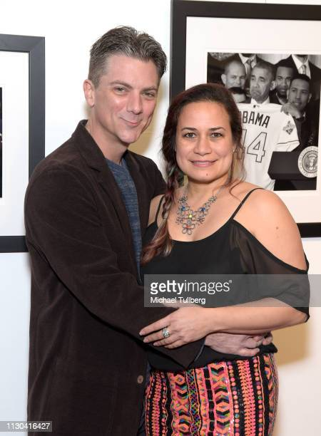 Actor Jeremy Miller and Joanie Miller attend the opening of photographer Anna Wilding's new exhibition Celebrate Hope The Obama White House...