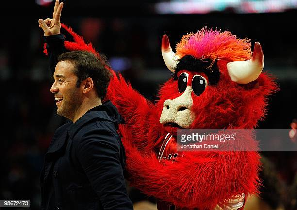 Actor Jeremy Piven jokes with Benny the Bull the mascot of the Chicago Bulls during a time out between the Bulls and the Cleveland Cavaliers in Game...
