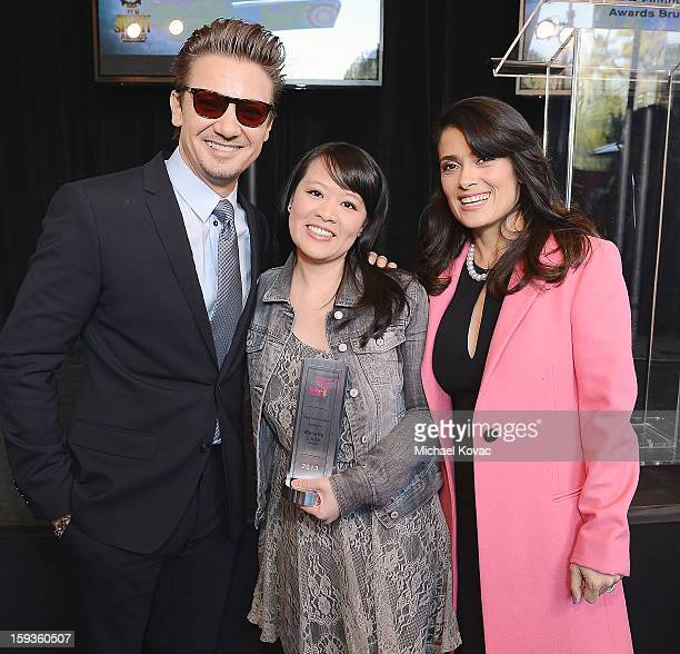 Actor Jeremy Renner and actress Salma Hayek pose with Piaget Producers Award winner Mynette Louie at the 2013 Film Independent Filmmaker Grant And...