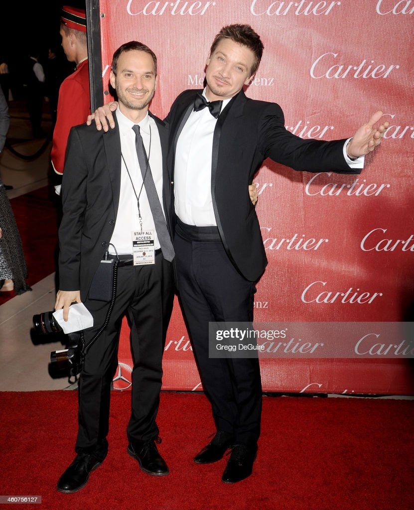 Actor Jeremy Renner (R) and photographer Jeff Vespa arrive at the 25th Annual Palm Springs International Film Festival Awards Gala at Palm Springs Convention Center on January 4, 2014 in Palm Springs, California.