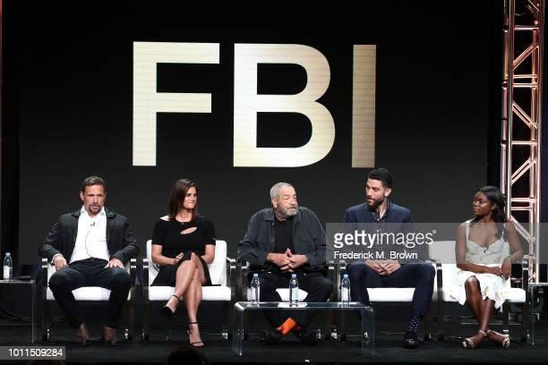 Actor Jeremy Sisto actress Missy Peregrym executive producer/writer Dick Wolf actor Zeeko Zaki and actress Ebonee Noel of the television show FBI...