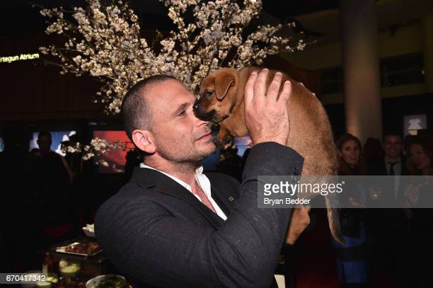 Actor Jeremy Sisto holds a puppy at National Geographic's Further Front Event at Jazz at Lincoln Center on April 19 2017 in New York City