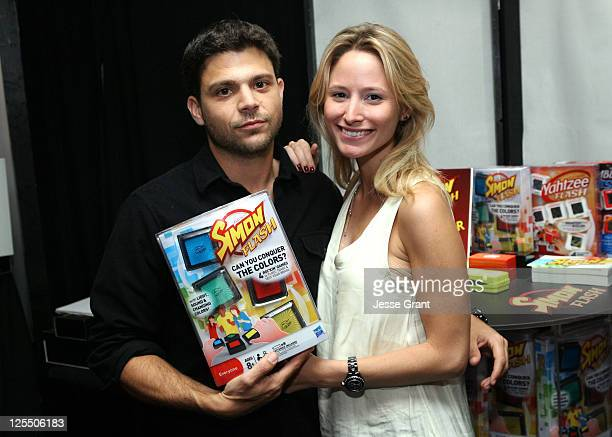 Actor Jerry Ferrara and Alexandra Blodgett attend The HP Touchsmart Gift Lounge backstage at the Nokia Theatre in celebration of The 63rd Primetime...