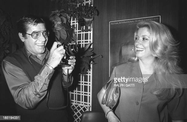 Actor Jerry Lewis holds his Nikon camera before taking a picture of French actress Catherine Deneuve during the 32nd International Movie Festival in...