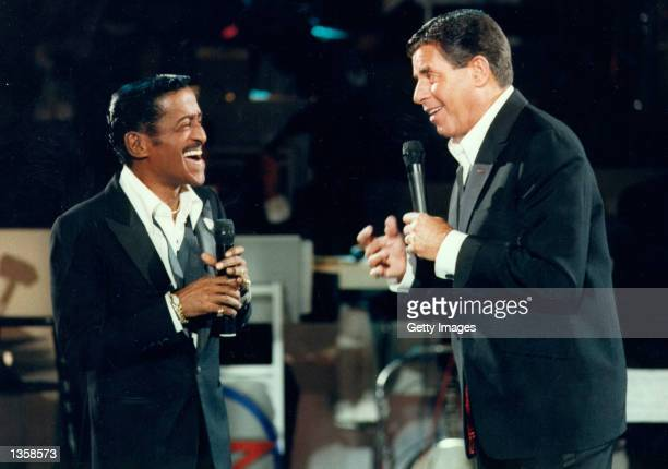 Actor Jerry Lewis performs with singer Sammy Davis Jr during the 1976 telecast of The Jerry Lewis MDA Telethon in Los Angeles California This Labor...