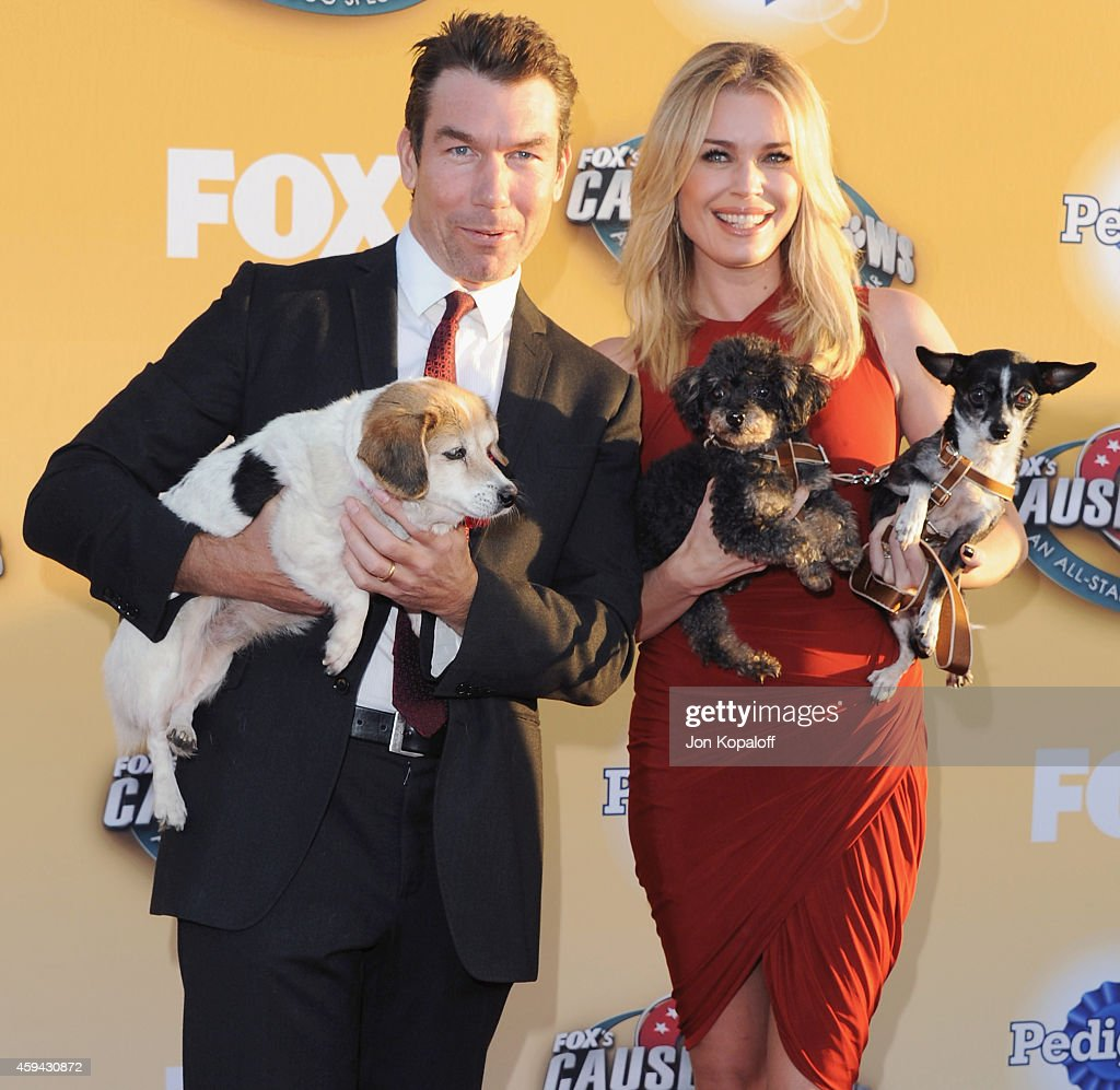 Actor Jerry O'Connell and wife actress Rebecca Romijn arrive at FOX's Cause For Paws: An All-Star Dog Spectacular at The Barker Hanger on November 22, 2014 in Santa Monica, California.
