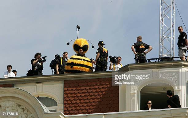 Actor Jerry Seinfeld prepares to slide down on a wire from the Carlton Hotel dressed as a bee to promote the film 'Bee Movie' during the 60th...