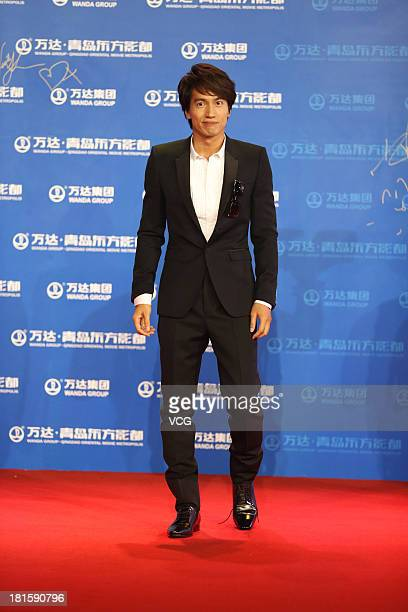 Actor Jerry Yan arrives on the red carpet during the opening night of the Qingdao Oriental Movie Metropolis at Qingdao Beer City on September 22 2013...