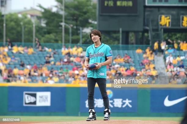 Actor Jerry Yan kicks off for a professional baseball game on May 14 2017 in Taipei Taiwan of China