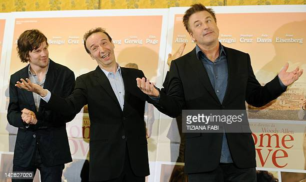 US actor Jesse Eisenberg Italian actor Roberto Benigni and US actor Alec Baldwin pose during the potocall of 'To Rome With Love' on April 13 2012 at...