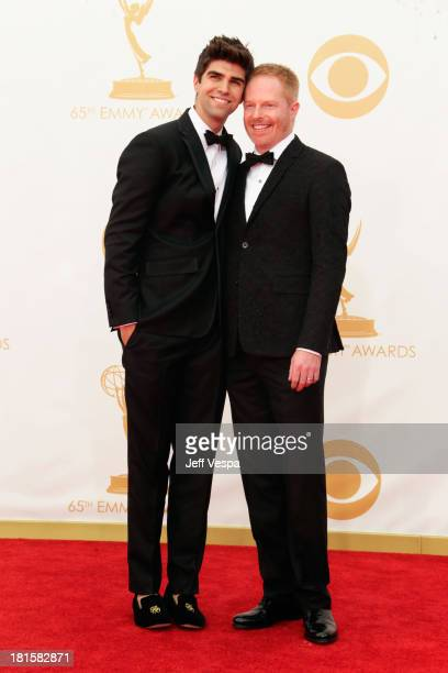 Actor Jesse Tyler Ferguson and actor Justin Mikita arrive at the 65th Annual Primetime Emmy Awards held at Nokia Theatre LA Live on September 22 2013...