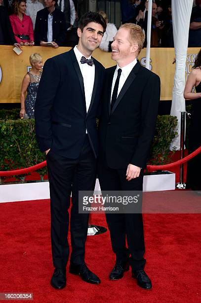 Actor Jesse Tyler Ferguson and Justin Mikita arrive at the 19th Annual Screen Actors Guild Awards held at The Shrine Auditorium on January 27 2013 in...