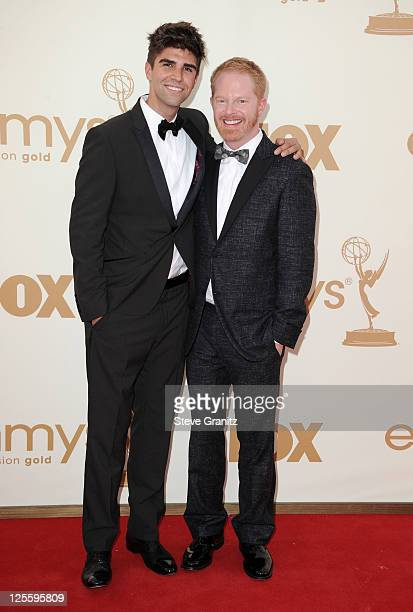 Actor Jesse Tyler Ferguson and Justin Mikita arrive to the 63rd Primetime Emmy Awards at the Nokia Theatre LA Live on September 18 2011 in Los...