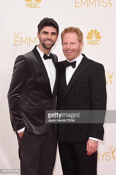 Actor Jesse Tyler Ferguson and Justin Mikita attend the 66th Annual Primetime Emmy Awards held at Nokia Theatre LA Live on August 25 2014 in Los...