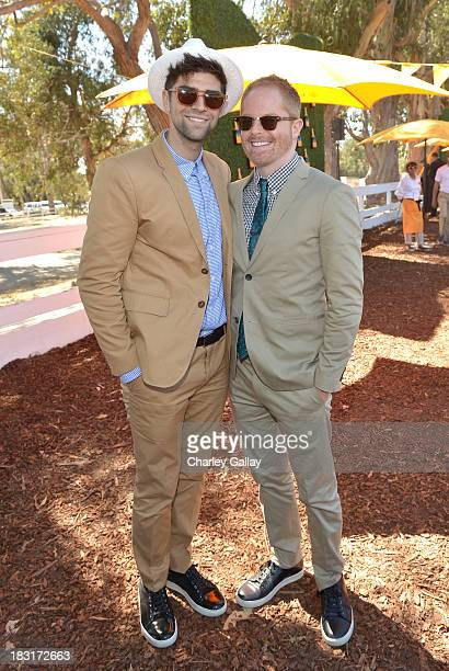 Actor Jesse Tyler Ferguson and Justin Mikita attend The FourthAnnual Veuve Clicquot Polo Classic Los Angeles at Will Rogers State Historic Park on...