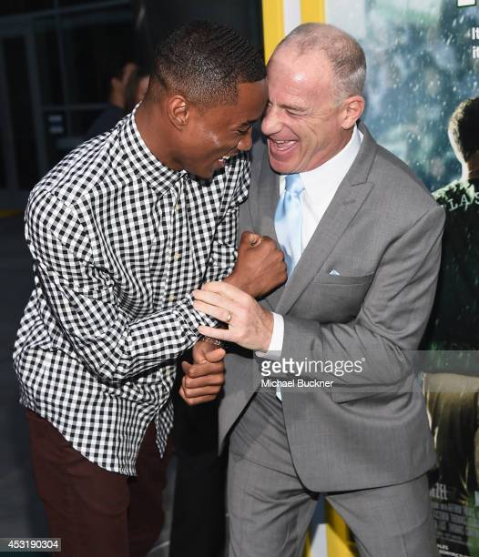 Actor Jesse Usher and producer David Zelon arrives at the premire of Tri Star Pictures' When The Game Stands Tall at the ArcLight Cinemas on August 4...