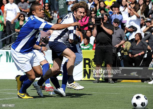 Actor Jesse Williams and actor David Bisbal fight for the ball at MTV Tr3s's Rock N' Gol World Cup KickOff at the Home Depot Center on March 31 2010...