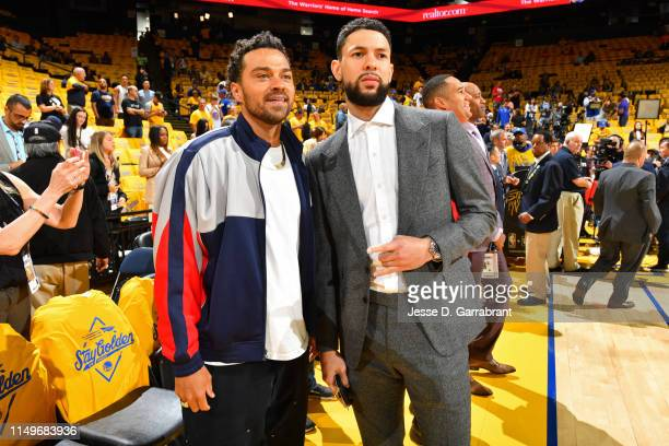 Actor Jesse Williams poses for a photo with Austin Rivers of the Houston Rockets on court before Game Four of the NBA Finals between the Toronto...