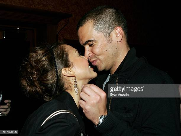 Actor Jessica Alba and boyfriend Cash Warren kiss in the green room during the 'Jimmy Kimmel Live' Show at Super Bowl XL February 3 2006 at the Gem...