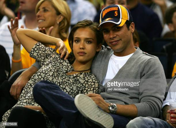 Actor Jessica Alba looks on with Cash Warren during the Dallas Mavericks and the Golden State Warriors Game Four of the Western Conference...