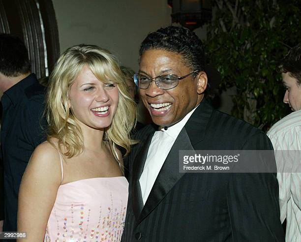 Actor Jessica Boehrs and recording Herbie Hancock attend the after party for the film premiere of Eurotrip at the Cinegrill on February 17 2004 in...
