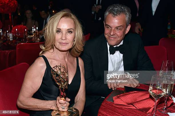 Actor Jessica Lange winner of the 'Outstanding lead in a miniseries or a movie' award for American Horror StoryCoven and actor John Huston attend the...