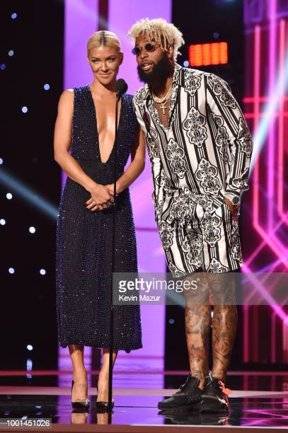Actor Jessica Szohr and NFL player Odell Beckham Jr speak onstage at The 2018 ESPYS at Microsoft Theater on July 18 2018 in Los Angeles California
