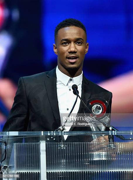 Actor Jessie Usher accepts the Ensemble of the Universe Award for Independence Day Resurgence during the CinemaCon Big Screen Achievement Awards...