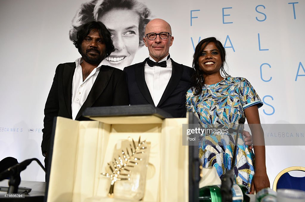 Actor Jesuthasan Antonythasan, director Jacques Audiard and actress Kalieaswari Srinivasan pose with Palme d'Or won for 'Dheepan' during the Palme D'Or Winners press conference during the 68th annual Cannes Film Festival on May 24, 2015 in Cannes, France.