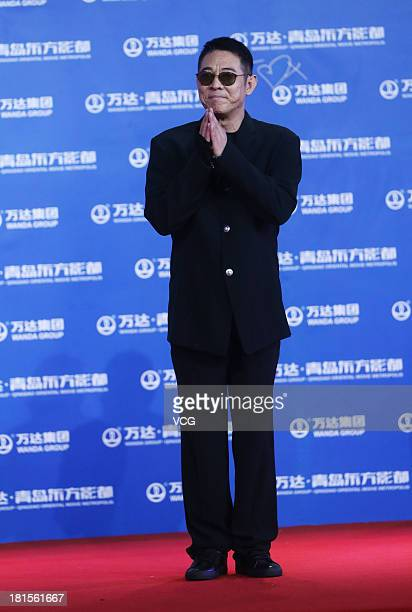 Actor Jet Li arrives at the red carpet during the opening night of the Qingdao Oriental Movie Metropolis at Qingdao Beer City on September 22 2013 in...