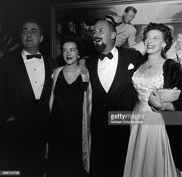 Actor Jim Backus Sharley Hudson actor Keenan Wynn and Henny Backus attend the premiere of The High and The Mighty in Los AngelesCA