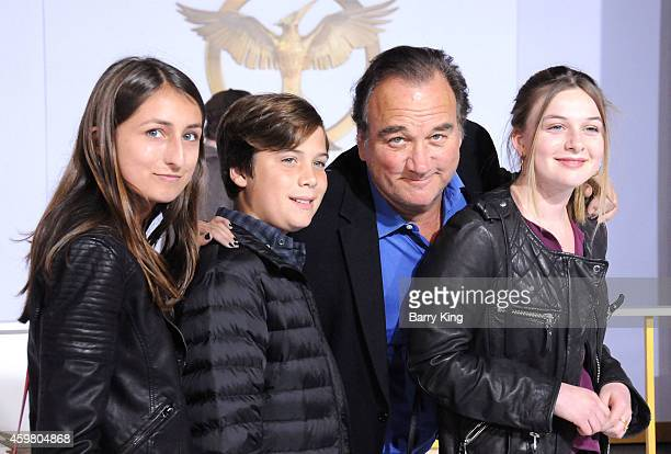 Actor Jim Belushi and Jamison Bess Belushi and guests arrive at the Los Angeles Premiere 'the Hunger Games Mockingjay Part 1' at Nokia Theatre LA...