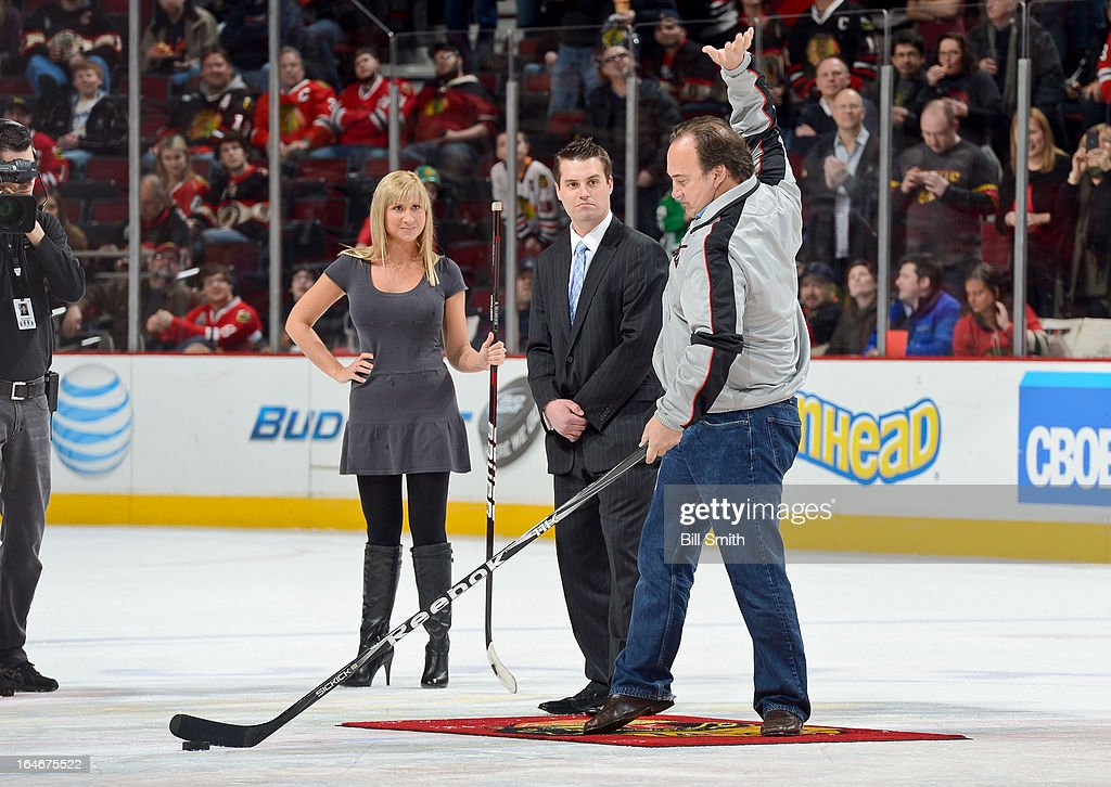 Actor Jim Belushi gets the crowd going before he shoots the puck in between periods of the NHL game between the Los Angeles Kings and the Chicago Blackhawks on March 25, 2013 at the United Center in Chicago, Illinois.