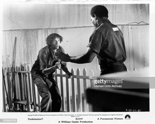 Actor Jim Brown and actor Ben Carruthers on set of the Paramount Pictures movie Riot in 1969