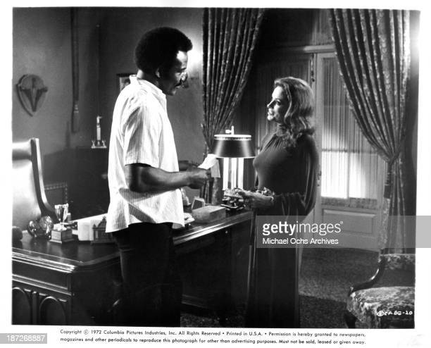 """Actor Jim Brown and actress Luciana Paluzzi on set of the Columbia Pictures movie """"Black Gunn"""" in 1972."""