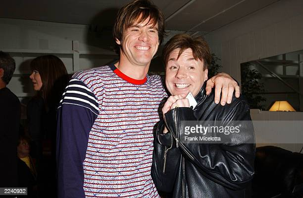 Actor Jim Carrey and Mike Myers mingle backstage during Nickelodeon's 16th Annual Kids' Choice Awards at the Barker Hangar on April 12 2003 in Santa...