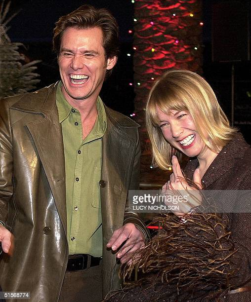 US actor Jim Carrey appears with his girlfriend actress Renee Zellweger as he arrives to the premiere of his new film Dr Seuss' How The Grinch Stole...