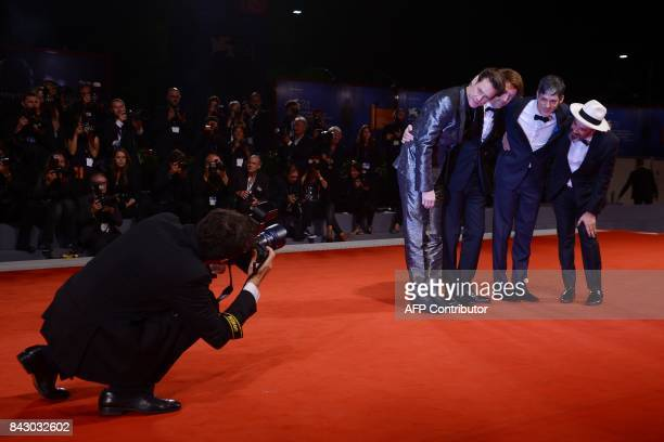 TOPSHOT Actor Jim Carrey director Chris Smith producer Danny Gabai and producer Eddy Moretti attend the premiere of the movie 'Jim Andy The Great...