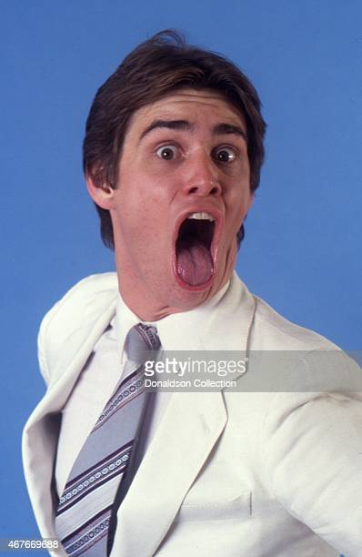Actor Jim Carrey impersonates Mick Jagger as he poses for a portrait session in circa 1992 in Los Angeles California