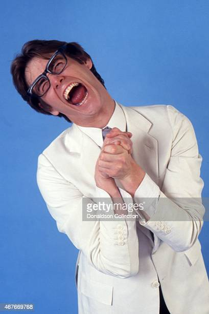 Actor Jim Carrey impersonates The Amazing Kreskin as he poses for a portrait session in circa 1992 in Los Angeles California