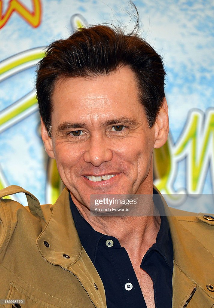 Actor Jim Carrey poses before signing copies of his new children's book 'How Roland Rolls' at Barnes & Noble bookstore at The Grove on October 26, 2013 in Los Angeles, California.